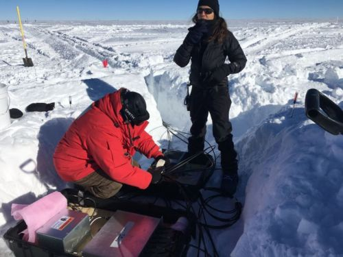 The perils of upgrading a particle detector buried in Antarctic ice