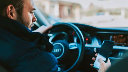 Australian drivers could be banned from all device use in impending law review