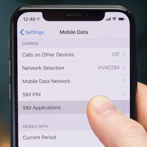How to access the SIM card applications and services on iPhone
