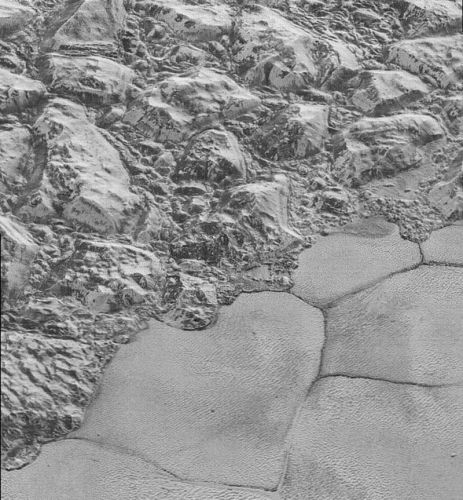 Frozen Pluto has wind-blown dunes made of methane sand