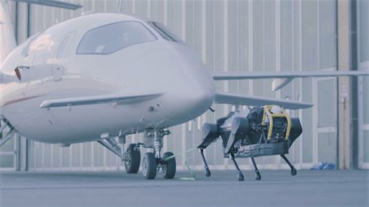 Watch this plucky little robot dog pull a three-ton plane