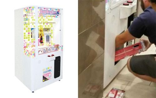 Dad makes toddler climb inside prize machine to steal Nintendo consoles