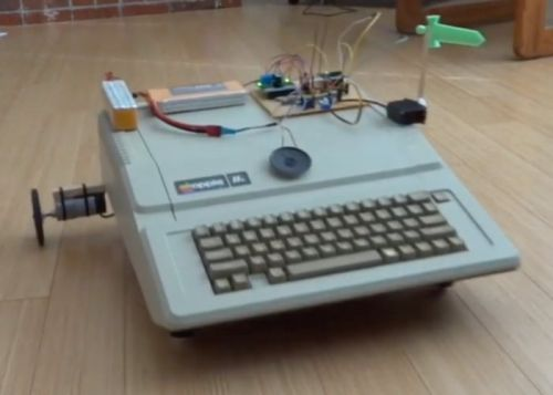 Vintage Apple IIe computer transformed into cute robot