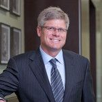 Qualcomm CEO Mollenkopf says his company and Apple will eventually end their feud